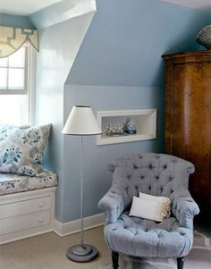 Love the the corner of this pretty blue bedroom...a cute reading chair and lovely window seat.