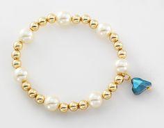 Pulsera con 4 baños de oro de 18 kilates, perlas y piedras de cristal.