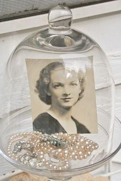 """Simple but oh so ever """" poignant """"- I love this feminine with her pearls and the cover keeping dust away........so sweet."""