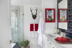 No animals were harmed making the acrylic antlers. Interior designer Brian Patrick Flynn chose antlers for an organic farmhouse vibe that's echoed throughout the house.
