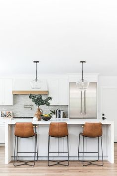10 Brown Leather Counter Chairs for a Modern Farmhouse Vibe Brown Leather Counter Chairs around white kitchen island via Puresaltinteriors Home Decor Kitchen, Kitchen Living, New Kitchen, Home Kitchens, Living Room, Modern Kitchen Design, Interior Design Kitchen, Home Design, Kitchen Designs