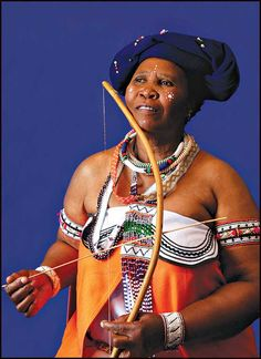 Xhosa woman wearing traditional attire with native wooden violin in her hand. The Xhosa people lives in SOUTH AFRICA African Tribes, African Diaspora, African Men, African Beauty, African Fashion, African History, Men's Fashion, Xhosa Attire, My Black Is Beautiful