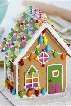 Enjoy the holidays by decorating a gingerbread house with your loved ones. Find easy gingerbread house ideas and more at Wilton. Gingerbread House Pictures, Gingerbread House Designs, Gingerbread House Parties, Christmas Gingerbread House, Gingerbread Cookies, Christmas Houses, Christmas Desserts, Christmas Treats, Christmas Baking