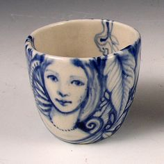 Little blue and white porcelain cup with faces by PSPorcelain