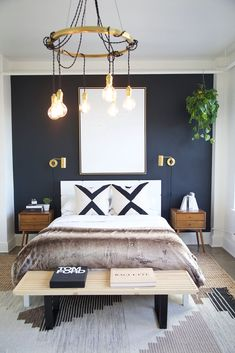 Go Inside 5 Of The Dreamiest Lofts In America modern boho bedroom decor, modern bedroom with navy wall and brass sconce, modern bedroom light, boho bedding, boho bedroom design with faux fur and nightstand decor Blue Accent Walls, Accent Wall Bedroom, Dark Blue Walls, Bedroom Wall Lights, Bedroom Ceiling, Lighting Ideas Bedroom, Navy Walls, Bedroom Light Fixtures, Bedroom Colors