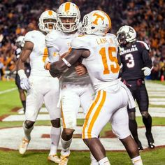 Tennessee quarterback Joshua Dobbs (11) and running back Marlin Lane (15) celebrate one of three rushing touchdowns by Dobbs in the Vols' overtime win at South Carolina.