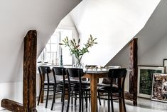 The dining room was arranged, putting the table in the window niche.  The furniture is massive, simple and wooden, almost perfectly ...