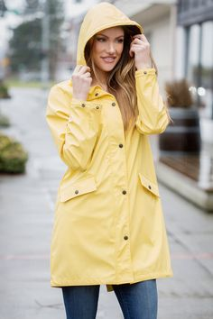 Raincoats are so practical, but they don't have to be boring! This raincoat is both functional and stylish. The snaps on the sleeves allow you to fasten them when rolled up, giving it a completely different look. You will stay dry and look super cute in this coat this Spring!