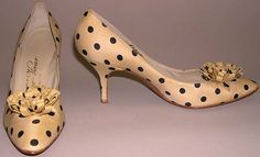 Designed by Roger Vivier in 1958. These shoes are made from silk and leather. The shoes are currently at the Metropolitan Museum of Art.