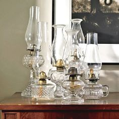 Antique glass oil lamps , also known as hurricane lamps