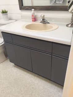 Bathroom Update + How to Paint Laminate Cabinets