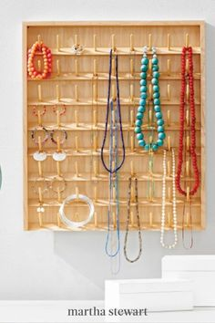 Keep your necklaces, bracelets, and earrings in fine order by repurposing an old spool rack. Where the individual spokes typically store sewing thread, they hold your necklaces and bangles. Mount the rack to a wall, or set one with legs on a vanity. #marthastewart #crafts #diyideas #easycrafts #jewelry