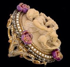 Lava stone cameo ring by Lydia Courteille. Yellow gold and silver, white and brown diamonds, enamel