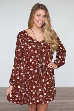 Shop our Ember Long Sleeve Floral Dress. Long sleeve rust colored dress…