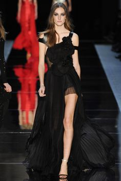 Alexandre Vauthier Spring 2016 Couture: Another sexy gown that I could see Alessandra Ambrosio Rosie Huntington-Whitely or Adriana Lima wear to a red carpet event. I love the chiffon, rosette detail, leather straps, and slit.