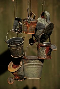 Rusty and galvanized pieces in a wind chime Galvanized Buckets, Galvanized Metal, Tin Pails, Vintage Diner, Milk Cans, Rustic Gardens, Yard Art, Wind Chimes, Old Things