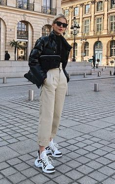 What s with All these Ugly Shoe Trends dad sneakers outfits ugly shoe trends khaki trousers puffer jacket fanny pack crossbody bag paris street style Fashion Mode, Look Fashion, Winter Fashion, Fashion Trends, 20s Fashion, Fashion Styles, French Fashion, Vintage Fashion, Fashion Tips