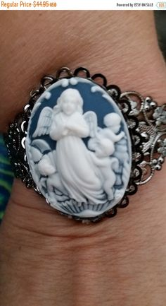 ❘❘❙❙❚❚ ON SALE ❚❚❙❙❘❘     Gorgeous Angels Cameo on Lacey Cuff Bracelet Cameo Brooch--Creamy Winter White on Gorgeous Blue background...absolutely stunning... valued at over $48...offered at a  low price...    SPECIALS:    20-25% off Jewelry items...SALE...    FREE Shipping on 2nd thru 8th jewelry items when purchased within 24 hrs of 1st item    Specials throughout our Shop here on Etsy...    Thanks for visitng our Site here on Etsy.  Happy Shopping for what you love…