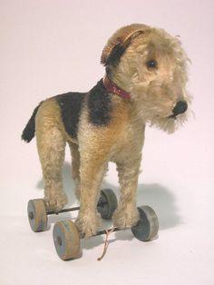 STEIFF DOG ON WHEELS  Brown and black mohair, terri : Lot 12