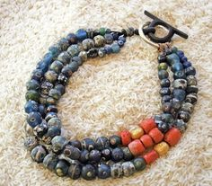 Trade Beads:  Ancient Roman Eye Beads (blue/yellow/green)/                        Antique Coral