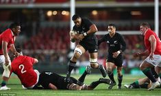 Jerome Kaino leaps over his grounded team-mate Brodie Retallick and into a pocket of space. Jerome Kaino, British And Irish Lions, New Zealand, Pocket, Space, Floor Space, Bag, Spaces