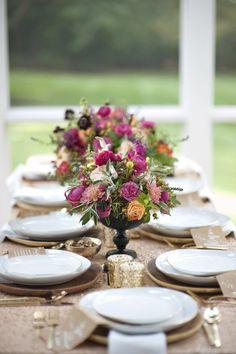 Love the flower arrangements in black urns.