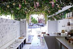 Lily of the Valley by Marie Deroudilhe is a tiny cafe in Paris with flowers hang from the entire ceiling - a vibrant little spot that's bursting with life.