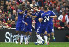 Eden Hazard Photos - Eden Hazard of Chelsea celebrates scoring the opening goal with team mates during the Barclays Premier League match between Liverpool and Chelsea at Anfield on May 11, 2016 in Liverpool, England. Liverpool v Chelsea - Premier League