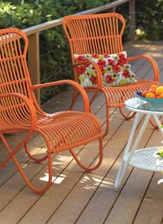 Orange chairs on the porch.