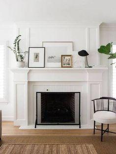 a white modern fireplace.