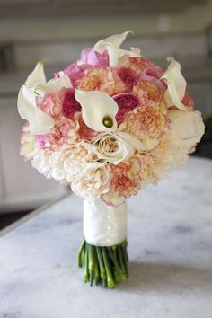 A June wedding bouquet created at Greenlife Grocery in Asheville with callas, carnations and garden roses