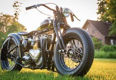 Seriously awesome Pre Unit Triumph motorcycle with custom hardtail frame, sprung solo seat with custom tooled leather pad, fat front/fat rear tire setup with a beautiful springer out front. Pic 3
