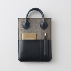 I want to take this Leather + Felt Tablet Case from Schoolhouse Electric & Supply Co. to my next biz meeting. So sophisticated!