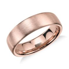 Modern in appeal this brushed 14k rose gold wedding band features a rounded interior for everyday comfort.