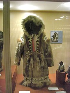 Fur coat with trim