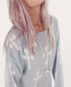 Sheer cross sweater, pretty hair, and necklace.