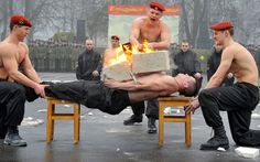 A Belarus Interior Ministry special forces soldier demonstrates his ability to sustain a blow during a competition to mark the Defenders of the Fatherland Day at their training centre outside Minsk. Belarus celebrates the Soviet holiday on February 23 each year alongside Russia and other countries of the former USSR. Following the fall of the Soviet Union in 1991, the holiday was given its current name in 2002 by Russian President Vladimir Putin.