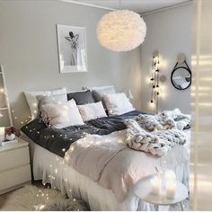 Neutral colors, soft and fuzzy textures, and dreamy lighting make this bedroom so relaxing and cozy!