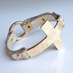 Our 'Gia' strap bracelet is anchored with a hammered metal side cross! #TheBangle