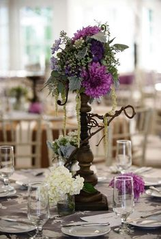 Rustic chic purple floral wedding reception centerpiece; Featured Photographer: Nadia D Photography