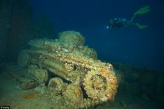 Fish food: Truk Lagoon, once considered the most formidable of all Japanese strongholds in the Pacific, is now the site for an underwater military graveyard. A tank lies rusting on the main deck of a sunken ship in the Federated States of Micronesia