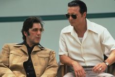 Still of Al Pacino and Johnny Depp on the set of Donnie Brasco, 1997