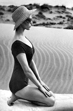 Model in McCardell's ribbed knit bathing suit, like a dancer's leotard, photo by Louise Dahl-Wolfe, Harper's Bazaar, 1953