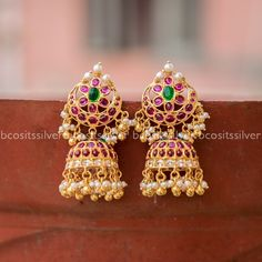 BCOS Earrings - 609 silver made with gold plated Measurements: Total stud length stud width center length center width Jumka dia : Semi precious cab stones and cubic zirconia, corals, fresh water Gold Jewelry Simple, Gold Wedding Jewelry, Silver Jewellery, Bridal Jewelry, Jhumka Designs, Gold Earrings Designs, Necklace Designs, Gold Jhumka Earrings, Gold Plated Earrings
