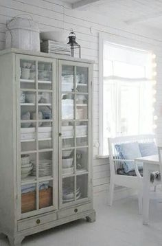 I like the plank walls and glass hutch.