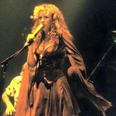Stevie Nicks with Fleetwood Mac.  Love the dress in this one.