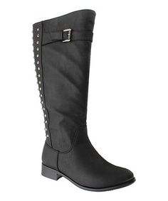 What's elegance without a little edge now and then? This boot's front exudes classic style, while its rock-star rivet back looks right on trend.