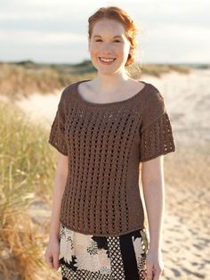 """Columns of easy lace adorn the body and sleeves of this drop-shoulder pullover with a wide scoop neck.  Sizes Directions are to fit women's size X-Small. Changes for sizes Small, Medium, Large, 1X and 2X are in parentheses. To Fit Bust Size: 30(34-38-42-46-50)""""  Finished Measurements Bust – 36(40-44-48-52-56)"""" Length – 21½(22-22½-23-24-24½)"""" Note: This garment was designed with approximately 4"""" of ease. Please take this into consideration when selecting your size."""