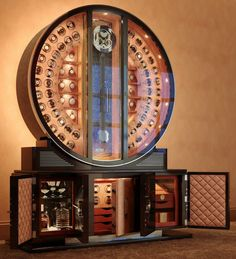 Dottling Watch Safes: just a cool $100K plus...oh...is that all? But hey...the watches spin for you--regularly.