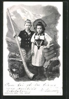 alte-AK-junge-Schweizer-in-Tracht-mit-Alphorn-1902                              …